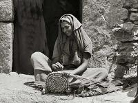 Arab Women Working Hand Mill