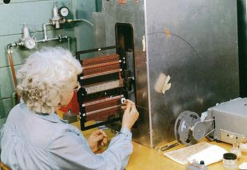 A technician weaving the core ropes at the Raytheon plant in suburban Boston.
