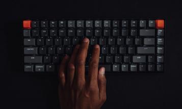 black hand on keyboard