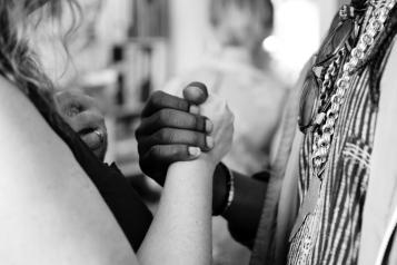 men and women shaking hands